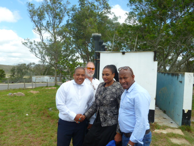Handing over refurbished toilets